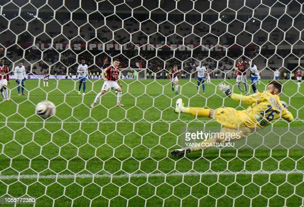 Nice's French midfielder Remi Walter shoots a penalty kick and scores a goal during the French League cup football match between Nice and Auxerre on...