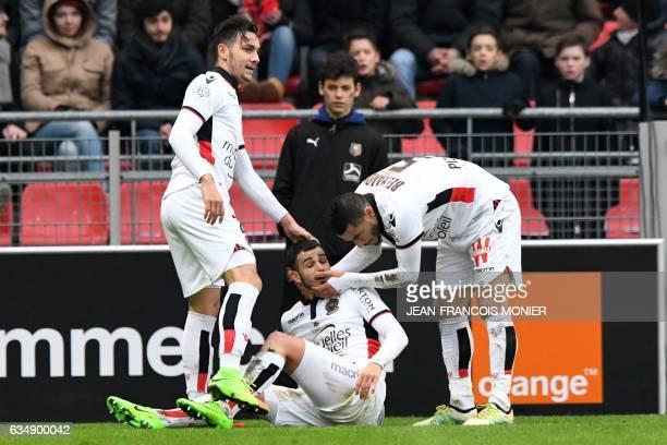 Nice's French midfielder Valentin Eysseric is congratulated by Nice's Greek forward Anastasios Donis and Nice's French-born Moroccan midfielder...