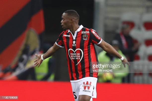 Nice's French midfielder Wylan Cyprien celebrates after scoring a goal during the French L1 football match between Nice and Toulouse on March 15,...