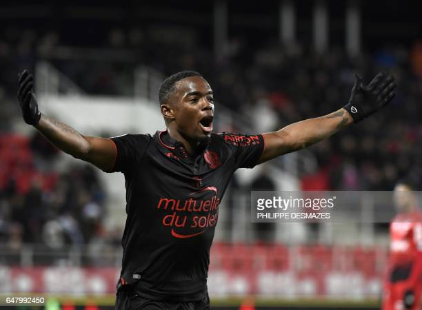 Nice's French midfielder Wylan Cyprien celebrates after scoring a goal during the French L1 football match Dijon against OGC Nice on March 4 2017 at...