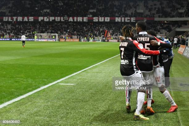 Nice's French midfielder Wylan Cyprien celebrates after scoring a goal during the French L1 football match Nice vs Lille on March 2 2018 at Allianz...