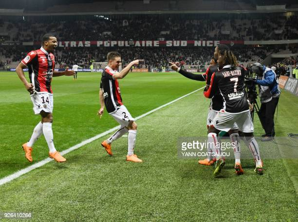 Nice's French midfielder Wylan Cyprien celebrates after scoring a goal with his teammates during the French L1 football match Nice vs Lille on March...