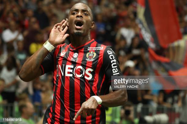 Nice's French midfielder Wylan Cyprien celebrates after scoring on a penalty kick during the French L1 football match between OGC Nice and Olympique...