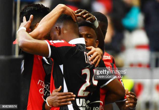 Nice's French midfielder Wylan Cyprien celebrates with team mates after scoring a goal during the French L1 football match between Nice and Saint...
