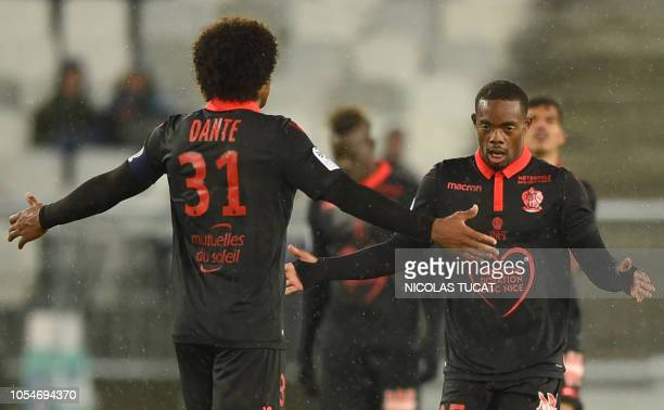 Nice's French midfielder Wylan Cyprien celebrates with teammates after scoring a goal during the French L1 football match between Bordeaux and Nice...
