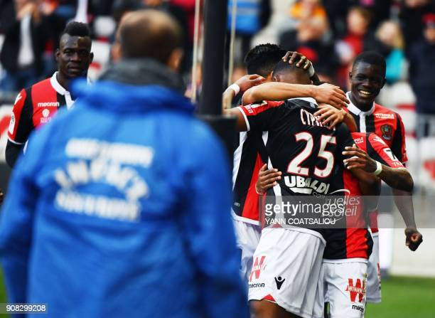 Nice's French midfielder Wylan Cyprien celebrates with teammates after scoring a goal during the French L1 football match between Nice and...