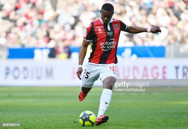 Nice's French midfielder Wylan Cyprien kicks the ball during the French L1 football match between Nice and Saint Etienne at the Allianz Riviera...