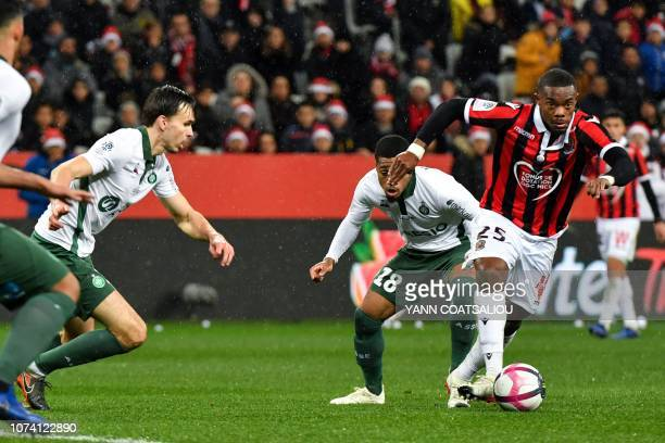 Nice's French midfielder Wylan Cyprien tries to control the ball during the French L1 football match between Nice and Saint Etienne at the 'Allianz...