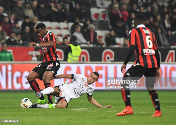 Nices French midfielder Wylan Cyprien vies with Montpellier's French midfielder Ellyes Skhiri during the French L1 football match OGC Nice vs...