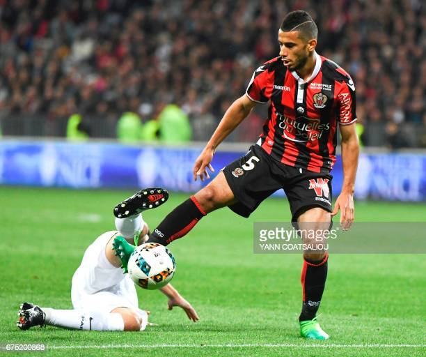 Nice's Frenchborn Moroccan midfielder Younes Belhanda controls the ball during the French L1 football match Nice vs Paris Saint Germain on April 30...
