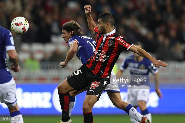 Nice's Frenchborn Moroccan midfielder Younes Belhanda vies with Bastia's French midfielder Yannick Cahuzac during the French L1 football match...