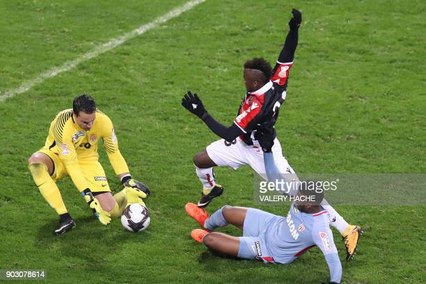 Nice's Ignatius Kpene Ganago vies with Monaco's Swiss goalkeeper Diego Benaglio and Monaco's Brazilian defender Jemerson during the French League Cup...