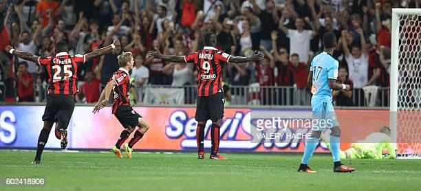 Nice's Italian forward Mario Balotelli celebrates after scoring a goal during the French L1 football match OGC Nice vs Olympique de Marseille on...