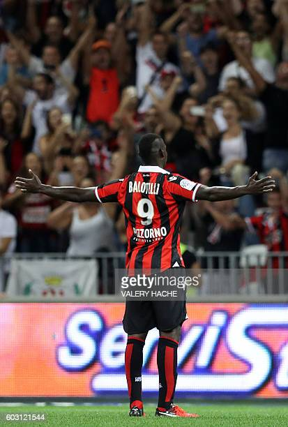 Nice's Italian forward Mario Balotelli celebrates after scoring a goal during the French L1 football match Nice vs Marseille on September 11 2016 at...