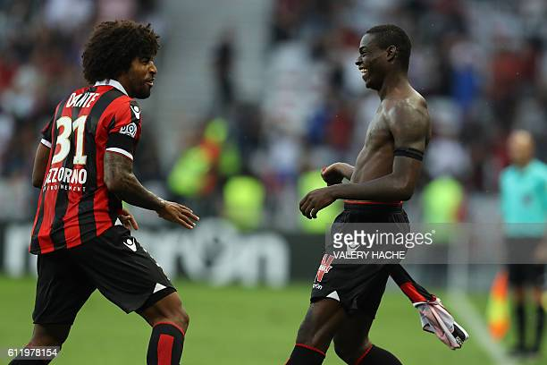Nice's Italian forward Mario Balotelli celebrates after scoring a goal with his teammate Brazilian defender Dante during the French L1 football match...