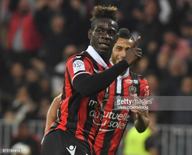 Nice's Italian forward Mario Balotelli celebrates after scoring a goal during the French L1 football match Nice vs Paris Saint Germain on April 30,...