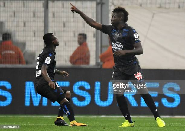 Nice's Italian forward Mario Balotelli celebrates after scoring a goal during the French L1 football match between Olympique de Marseille and Nice at...