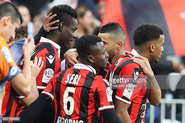 Nice's Italian forward Mario Balotelli celebrates with his teammates after scoring during the French L1 football match Nice vs Dijon on December 18...