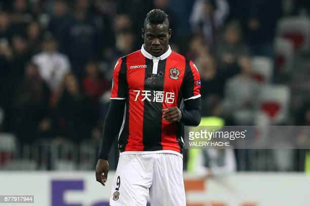 Nice's Italian forward Mario Balotelli celebrates with his teammates after scoring a goal during the UEFA Europa League football match between OGC...