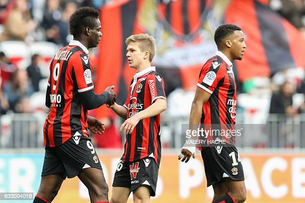 Nice's Italian forward Mario Balotelli celebrates with teammates after scoring a goal during the French L1 football match Nice vs Guingamp on January...