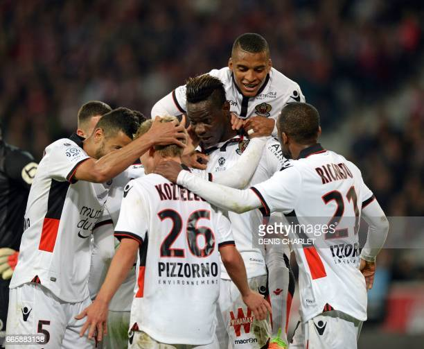 Nice's Italian forward Mario Balotelli celebrates with teammates after scoring a goal during the French L1 football match between Lille and Nice at...