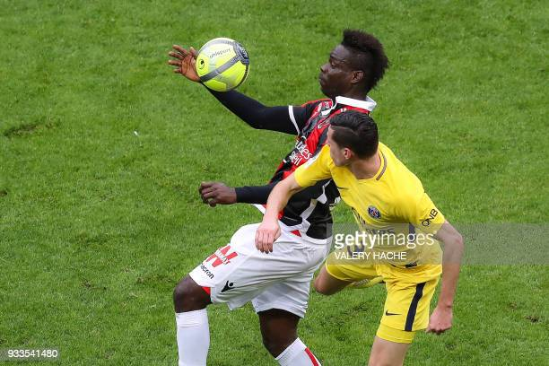 Nice's Italian forward Mario Balotelli chest controls the ball despite Paris SaintGermain's German midfielder Julian Draxler during the French L1...