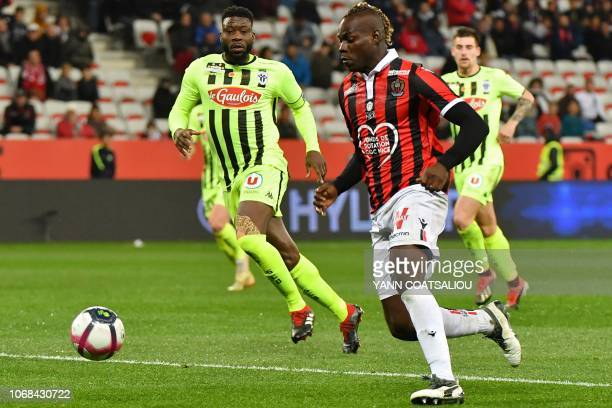 Nice's Italian forward Mario Balotelli drives the ball during the French L1 football match OGC Nice vs Angers SCO at Allianz Riviera stadium in Nice...