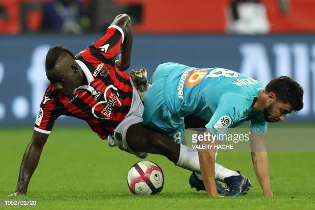 Nice's Italian forward Mario Balotelli fights for the ball with Olympique de Marseille's French midfielder Morgan Sanson during the French L1...