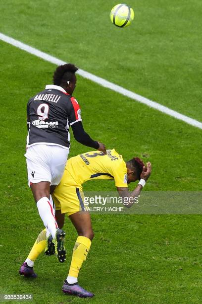 Nice's Italian forward Mario Balotelli fouls Paris SaintGermain's French defender Presnel Kimpembe as he heads the ball during the French L1 football...