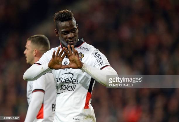 Nice's Italian forward Mario Balotelli gesture after scoring a goal during the French L1 football match between Lille and Nice at the Pierre-Mauroy...