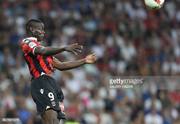 Nice's Italian forward Mario Balotelli heads the ball during the French L1 football match OGC Nice vs Olympique de Marseille on September 11 2016 at...
