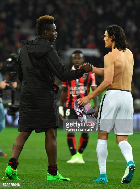 Nice's Italian forward Mario Balotelli is congratulated by Paris SaintGermain's Uruguayan forward Edinson Cavani as Nice celebrates their 31 win over...