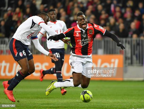 Nice's Italian forward Mario Balotelli is tackled by Lille's French midefielder Ibrahim Amadou during the French L1 football match Nice vs Lille on...