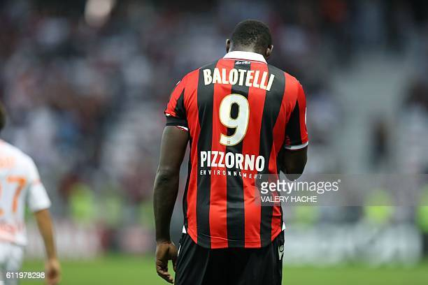 Nice's Italian forward Mario Balotelli leaves the pitch after receiving a red card for taking off his jersey during the French L1 football match Nice...