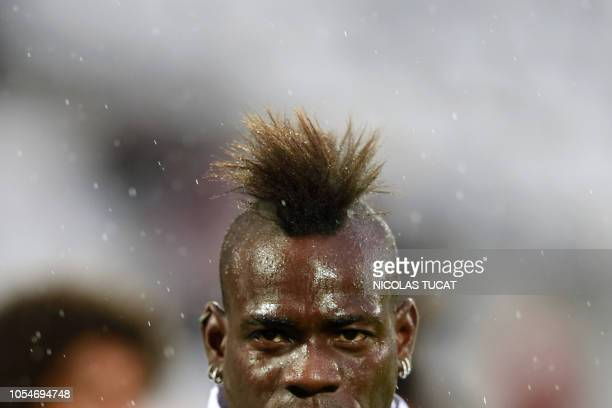 TOPSHOT Nice's Italian forward Mario Balotelli looks on during the warm up prior to the French L1 football match between Bordeaux and Nice on October...