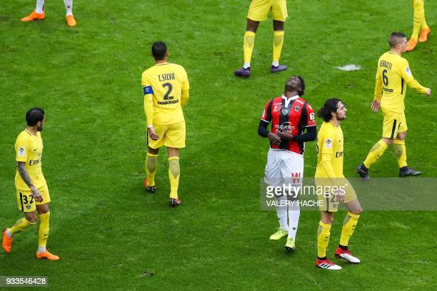 Nice's Italian forward Mario Balotelli racts after missing a shot during the French L1 football match Nice vs Paris SaintGermain on March 18 2018 at...