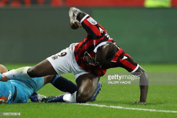 Nice's Italian forward Mario Balotelli reacts after a challenge during the French L1 football match between Nice and Marseille at Allianz Riviera...