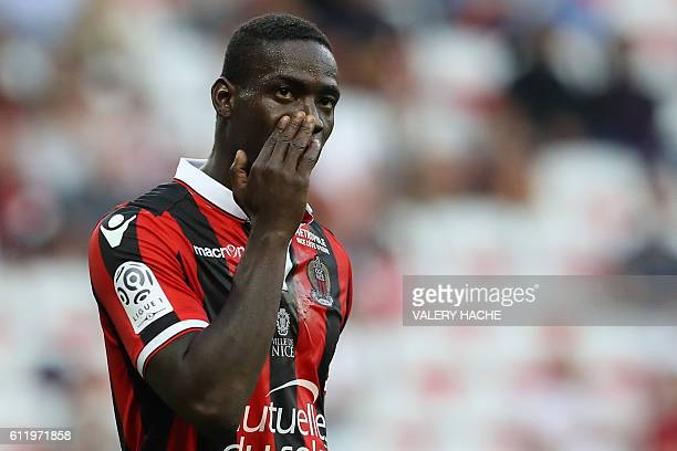 Nice's Italian forward Mario Balotelli reacts during the French L1 football match between Nice and Lorient at the Allianz Riviera stadium in Nice...