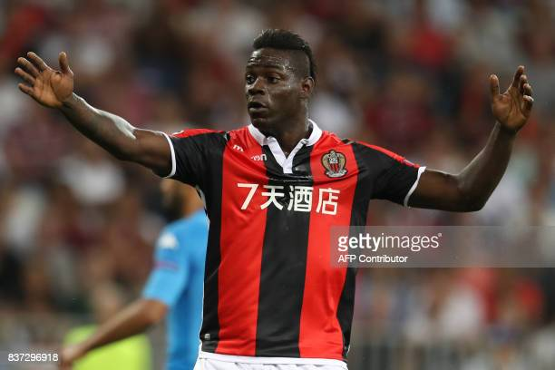 Nice's Italian forward Mario Balotelli reacts during the UEFA Champions League playoff football match between Nice and Napoli at the Allianz Riviera...