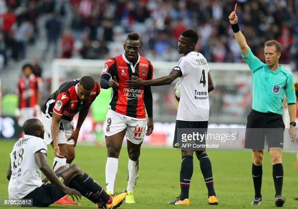 Nice's Italian forward Mario Balotelli receives a red card by French referee Olivier Thual during the French L1 football match between and Dijon on...