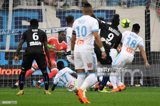 Nice's Italian forward Mario Balotelli scores the first goal during the French L1 football match between Olympique de Marseille and Nice at the...