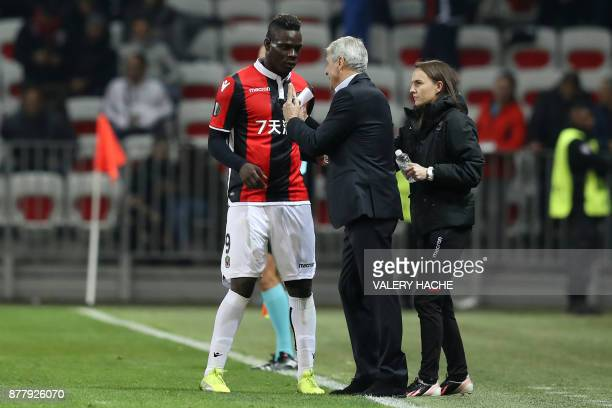 Nice's Italian forward Mario Balotelli speaks to Nice's Swiss head coach Lucien Favre after scoring a goal during the UEFA Europa League football...
