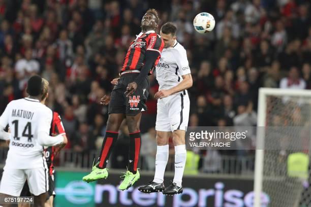 Nice's Italian forward Mario Balotelli vies for the ball with Paris SaintGermain's Italian midfielder Thiago Motta during the French L1 football...