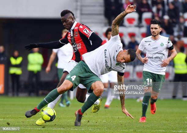 Nice's Italian forward Mario Balotelli vies vith SaintEtienne's French defender Leo Lacroix during the French L1 football match between Nice and...