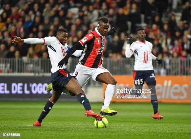 Nice's Italian forward Mario Balotelli vies with Lille's French midefielder Ibrahim Amadou during the French L1 football match Nice vs Lille on March...