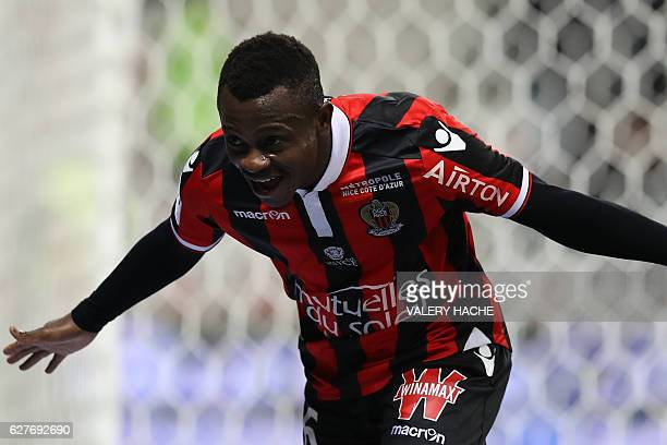 TOPSHOT Nice's Ivorian midfielder Jean Michael Seri celebrates after scoring a goalduring the French L1 football match Nice vs Toulouse on December 4...