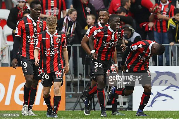 Nice's Ivorian midfielder Jean Michael Seri celebrates with teammates after scoring a goal during the French L1 football match Nice vs Guingamp on...
