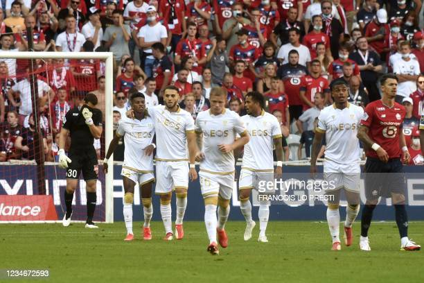 Nice's midfielder Hicham Boudaoui is congratuled by teamates after scoring during the French L1 football match between Lille and Nice on August 14,...