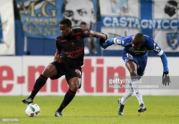 Nice's midfielder Wylan Cyprien vies with Bastia's French midfielder Prince Oniangue during the L1 football match Bastia against Nice on January 20...