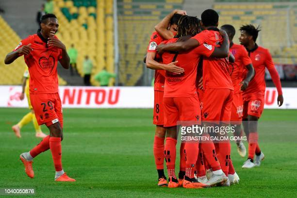 Nice's players celebrate a goal during the French L1 football match between Nantes and Nice at the La Beaujoire stadium in Nantes western France on...